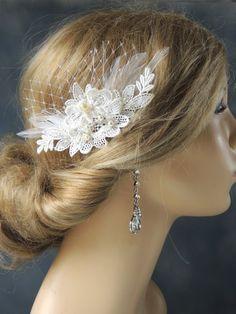 Bridal mini birdcage veil with Hair comb, Wedding Fascinator, bridal hair comb, Wedding Hair Accessory. $38.95, via Etsy.