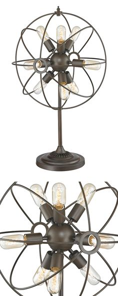 Celestial bodies are evoked with this beautifully orbital table lamp. Built from iron and featuring vintage-inspired bulbs, this piece is sure to take you to another time and place. Cozy spaces will lo...  Find the Galileo Table Lamp, as seen in the The Inventor's Lab Collection at http://dotandbo.com/collections/the-inventors-lab-1?utm_source=pinterest&utm_medium=organic&db_sku=113322