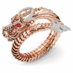 Diamond, ruby, and gold bracelet by Roberto Coin Roberto Coin's jewels are… Diamant-, Rubin- und Goldarmband von Roberto Coin Die … Bracelet Serpent, Dragon Bracelet, Ruby Bracelet, Dragon Jewelry, Snake Bracelet, Bracelets, Dragon Ring, Gold Dragon, Pearl Necklace