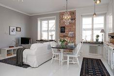 Что такое квартира-студия: разбираемся в квартирном вопросе http://happymodern.ru/chto-takoe-kvartira-studiya-razbiraemsya-v-kvartirnom-voprose/ Кирпичная стена визуально отделяет гостиную от кухни