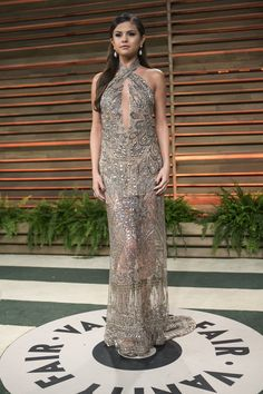 Pin for Later: Selena Gomez Brings Out Her Best Style Every Time It's Time For an Oscars Party 2014 Wearing Emilio Pucci.