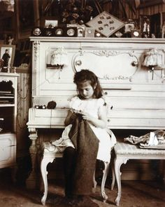 Grand Duchess Anastasia of Russia knitting in her mother's boudoir.
