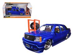 """2002 Cadillac Escalade EXT Blue """"Just Trucks"""" with Extra Wheels 1/24 Diecast Car Model by Jada - Brand new 1:24 scale diecast model car of 2002 Cadillac Escalade EXT Blue """"Just Trucks"""" with Extra Wheels die cast car model by Jada. Rubber tires. Brand new box. Detailed interior, exterior. Has opening doors, hood and rear gate. Made of diecast with some plastic parts. Dimensions approximately L-8.25, W-3.25, H-3.5 inches. Please note that manufacturer may change packing box at anytime. Product…"""