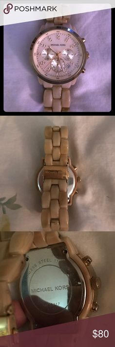Michael Kors Mother of Pearl Ceramic Watch Gorgeous watch in good condition with light scratches from normal wear and one bigger scratch on the face as shown. New battery and I may have the box if desired. Michael Kors Accessories Watches