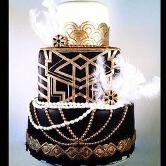 This cake is way too intense...but top and middle tier art deco is nice