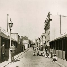 """circa 1906 looking south along Athlone Place from Ultimo Street in Ultimo. Athlone Place was resumed by Council in 1906, when some 400 dwellings and a maze of tiny lanes were removed. The area was subject to flooding and it was considered a """"deplorable slum"""""""