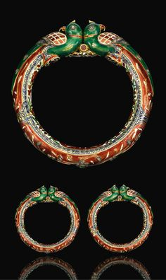North India | Pair of enamelled and gilded parrot head bracelets | 19th century | Est. 5'000 - 8'000£ ~ (Sept '14)