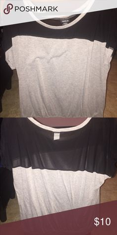 Cute gray top with black sheer Cute and comfy blouse. Gray and black, black part is sheer. Torrid size 1 torrid Tops Blouses