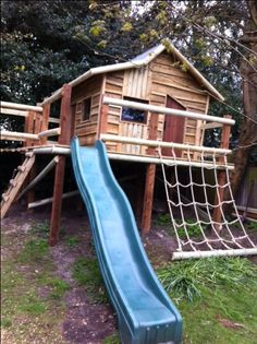 Reminiscent of the houses found in the Three Little Pigs, Little Red Riding Hood and Hansel & Gretel, our crooked tree house looks like a cottage out of a fairy tale! The play area is complete with a plastic slide, cargo net, swings, a fireman's pole and bridge.