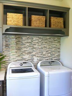Tile behind washer dryer/rod above