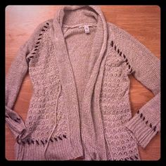 American Rag cardigan This sweater is very cute and there's a lot to it.  From the soft wide stitching on the arms to the little rose pattern sewn into the front it is very cute and shrug like American Rag Sweaters Cardigans