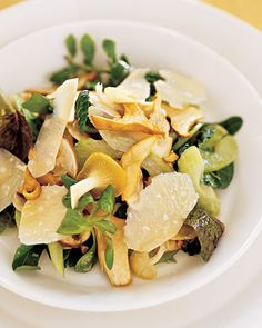 Mushroom-and-Celery Salad with Parmesan Cheese | Martha Stewart Living - This delicately dressed salad includes shaved Parmesan, celery, baby lettuce, and oyster and chanterelle mushrooms.