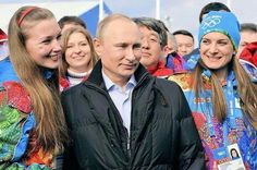 Russian President Vladimir Putin (C) and Olympic Village Mayor Elena Isinbaeva (R) visit the Coastal Cluster Olympic Village ahead of the Sochi 2014 Winter Olympics at the Athletes Village in Sochi, Feb. Wladimir Putin, Olympic Village, Destroyer Of Worlds, Many Men, Winter Olympics, Comebacks, Athletes, Russia Winter, Coastal