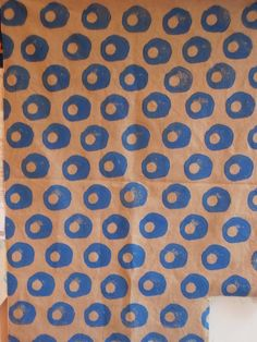 I always forget about potato stamping! Blue potato print on fabric.
