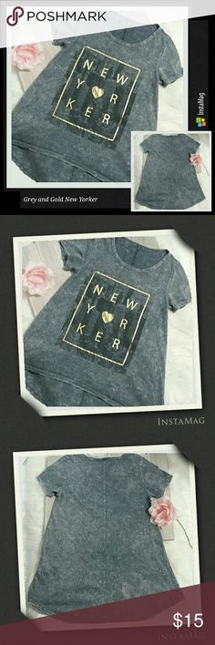 "New Yorker Grey and Gold high/low top New Yorker Grey and Gold top size small. Wear with black leggings and gold jewelry for a polished look out. Length: 21.5"" (front) 26"" (back) Chest: (underarm to underarm front) 15.5"". 100% cotton. Tops Tees - Short Sleeve"