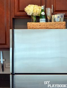 Corral the clutter on your fridge with a @homegoods  wicker tray to hold your kitchen essentials.  #HomeGoodsHappy #DIY #Organize
