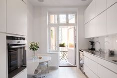 Your modern home decor will never be the same. Narrow Kitchen, Kitchen Dining, Kitchen Cabinets, Dining Nook, Scandinavian Home, Kitchen Interior, Home Kitchens, Sweet Home, Architecture