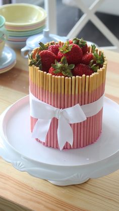 This cake is full of strawberry goodness, including the beautiful strawberry Pocky placed around the cake!