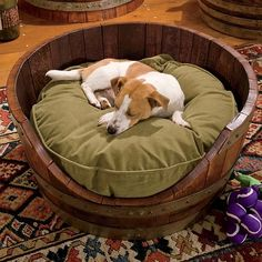 "Wine Barrel Dog Bed  Crafted from an actual retired white oak wine barrel and solid white pine, this round wooden dog bed is perfectly sized to fit our small round dog's Measures 13""H x 27""W x 10½""D. Round wooden dog bed is for dogs up to 25 lbs."