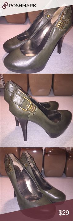 Guess Classic Olive High Heel Pump Sz 7.5 This is a classic cut but sexy added to design of Pump by Guess.  The heel(s) measure 5 inches tall for you fashionista's seeking a taller heel. Preowned in excellent condition.  There is slight minor flaw left shoe (see pic #7), but doesn't take away from anesthetic look (noted to protect Seller). Thanks for stopping by and have a great PoshMark Say! Guess Shoes Heels