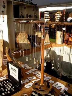 love this idea for display = love old wood and metal pieces incorporated in displays