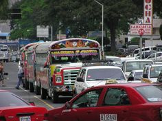 Rojo diablo bus and one of the ubiquitous red taxis in Panama City, Panama traffic. Photo by Anna Maria Virzi
