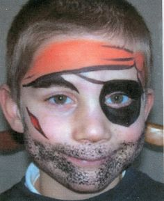 Face painting.  Pirate.  Only two colors.  Use a sponge for the beard.