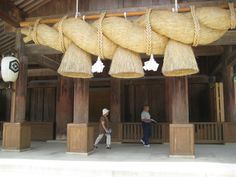Izumo Taisha Grand Shinto Shrine. Huge, straw 'shimenawa', twisted rope, over the entrance. Check out it's size in comparison to the people!