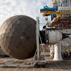 A GEnx engine being prepped for testing at GE Aviation in Peebles, OH. The large spherical structure is a Turbulence Control Structure (TCS), which helps enhance airflow during testing to maintain consistency in test results.