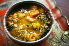 Kale and Roasted Vegetable Soup Recipe Soups with carrots, tomatoes, onion, butternut squash, garlic cloves, olive oil, vegetable broth, kale, thyme sprigs, bay leaf, great northern beans