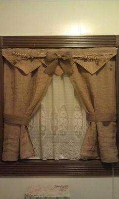 Gorgeous hand made burlap bathroom curtains with tie backs.