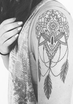 Tattoo of a dream catcher, mandala, lotus flower mashup. Ink by Christina Fleming, montreal. Dreamcatcher arm beautifull idea