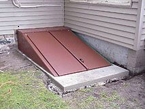 An Old Basement Access Door Is Demolished, New Concrete Is Poured To Form A  Smooth Level Base, And A New Bilco Steel Door Is Installed.