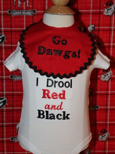 This adorable bodysuit comes with the detachable matching bib. The perfect gift for your Georgia Bulldog family or friends. The bodysuit is embroidered with the words, I Drool Red and Black, and the matching bib, is embroidered with Go Dawgs and trimmed with black rick rack. It ties in the back with red and black polka dot ribbon. Perfect for your little one's first tail gate or first football party. If you are buying this as a gift I can ship it directly for you and it will be gift wrapped…