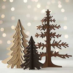 Graphic wood trees are laser-cut in realistic detail, easily assembled into dimensional, freestanding conversation pieces. Pieces assemble to create a modern, dimensional decoration great for table or mantel.