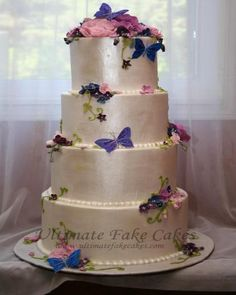 Butterflies and blooms adorned this 4-tier; 6 inch height cake and was inspired by the brides love for butterflies and flowers.