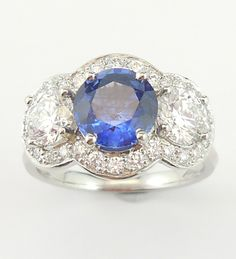 Gorgeous handmade engagement ring with blue Ceylon Sapphire with diamond clusters