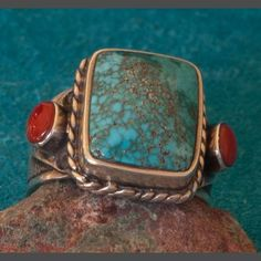 Turquoise Ring : This turquoise was probably mined circa 1960's - 1970's.The color is a subtle blue green with gold tone matrix. When you closely examine the very fine spider web the turquoise becomes quite fascinating. At first glance the turquoise appears to be old Lone Mountain but the Blue Green color seem more like #8 Turquoise or Fox. Regarless of its precise origin (which probably is Lander County Nevada) this is a spectacular and rare find to say the least.
