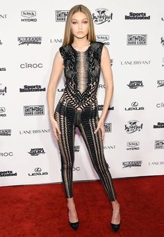 For the event, Gigi Hadid wore a sheer Julien Macdonald bodysuit embroidered with black beads that hugged her in all the right places.