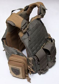 MSM (MilSpecMonkey) Stealth Pouch mounted on a grey Plate Carrier.