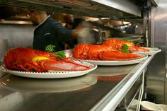 Freshly steamed lobsters on their way to the table.
