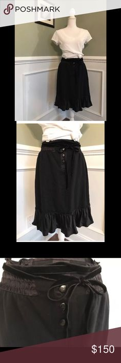 """Burberry Blue Label Ruffle Tie Skirt Size EU 38 Burberry Blue Label Women's Ruffle Tie Skirt Color Black Front Burberry logo button Detail with Ruffle on bottom. Velvet waist tie Size 38 EU Wonderful condition. Length 22"""" Shirt not included Burberry Skirts"""