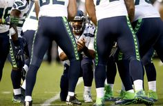 Russell Wilson Photos Photos - Russell Wilson #3 of the Seattle Seahawks huddles with his team during their preseason game against the Oakland Raiders at the Oakland Alameda County Coliseum on September 1, 2016 in Oakland, California. - Seattle Seahawks v Oakland Raiders