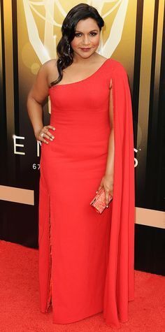 Mindy Kaling worked the 2015 Creative Arts Emmy Awards red carpet in an equally vibrant red column with a one-shoulder cape-like detail, which she showed off by swooping her hair to the side.