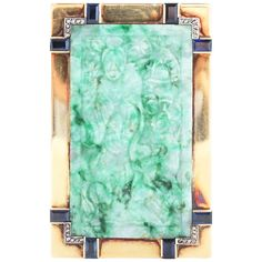 Art Deco Jade Sapphire Diamond Gold Box. This is a unique Art Deco gold box from the 1920s depicting a Chinese woodworker in a forest, carved in green jadeite, surrounded by rectangular cut sapphires and rose cut diamonds, set in 18k yellow gold. The box opens with a patented mystery mechanism. Numbered with maker's marks.