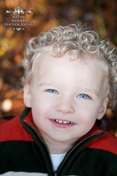 Adorable curly hair boy