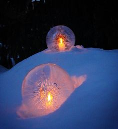 fill balloons with water, freeze, run hot water over ice (to clear the ice), and place a tea light inside!