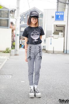 Miki on the street in Harajuku wearing a t-shirt and lace-up gingham pants from the Japanese brand Candy Stripper along with platform Converse and a Suicidal Tendencies cap.