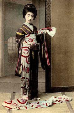 Famous Geisha TERUHA . Okinawa Soba, via Flickr. cica about 1900 - tying her obi