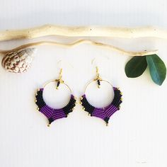 A personal favorite from my Etsy shop https://www.etsy.com/listing/579235819/macrame-earrings-diy-black-and-purple